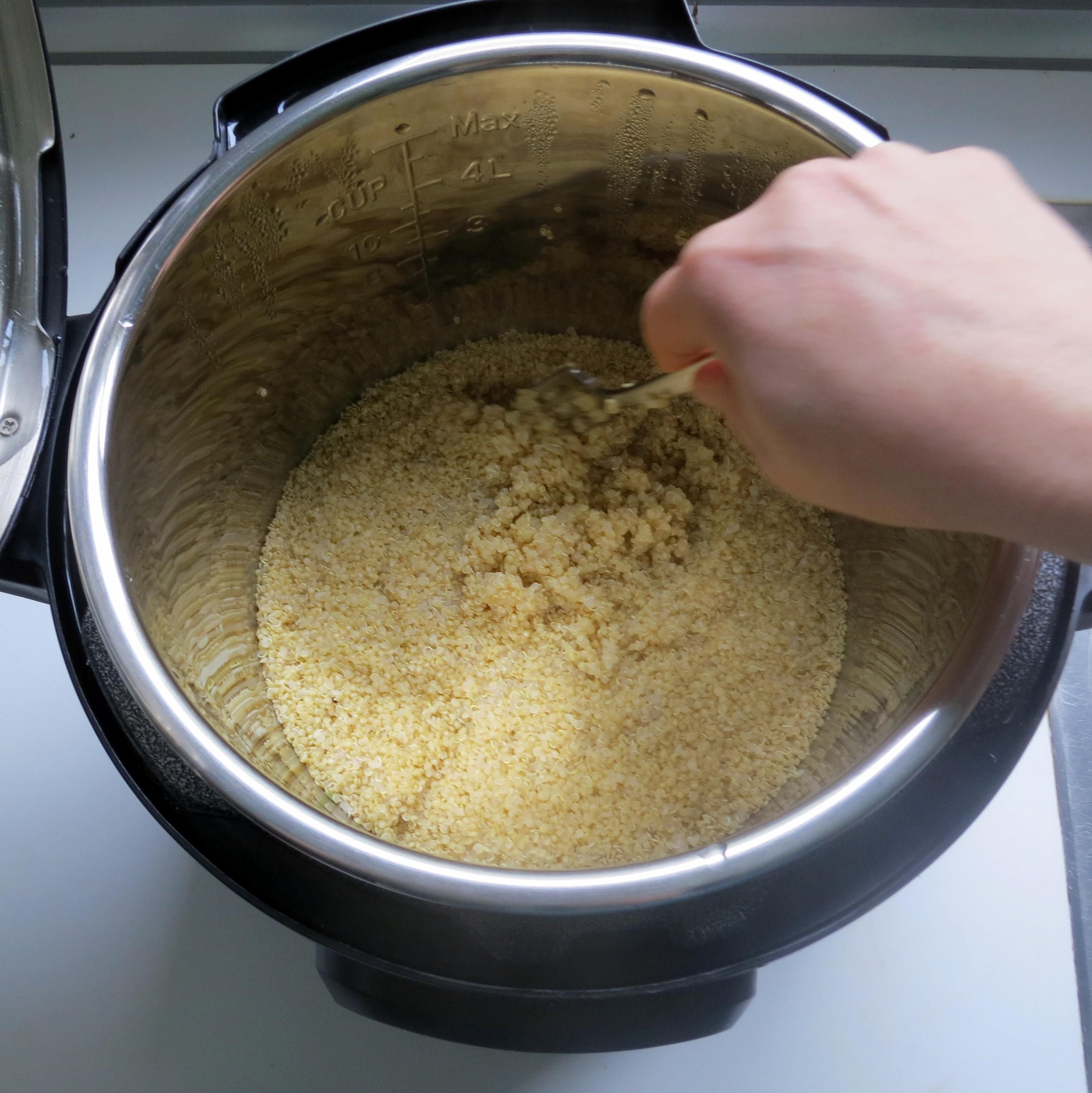 Fluffing pressure cooker quinoa.
