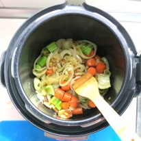 Add celery and carrots and saute' a bit more.