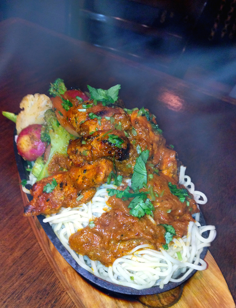 Yak & Yeti Sizzled chicken: it's a mainstay—and it really sizzles!