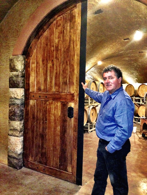 Seven Stones owner George Hanson shows off his new cellar, through custom built doors ©Tim Pawsey