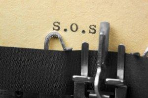 S.O.S. in old typewriter