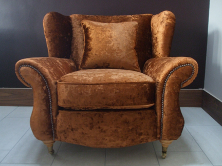 vintage armchair reupholstered in plush bronze coloured velvet fabric