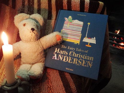 TASCHEN's Hans Christian Andersen Fairy Tales book with a teddy bear and lit candle