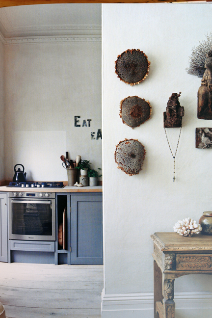 whitewashed walls with a group of natural wall hangings