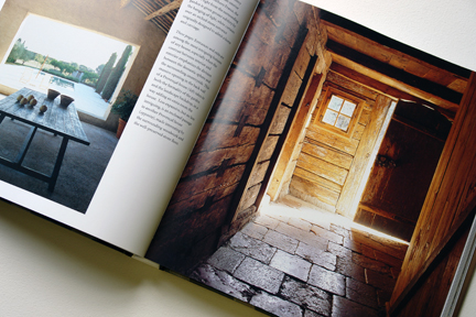 "double page spread showing an old stone flagged floor with sunlight streaming through from ""The Way We Live In the Country"" by Stafford Cliff & Gilles de Chabaneix"