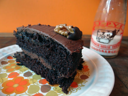 slice of double chocolate stout cake with a small vintage bottle with milk