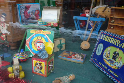 vintage toys and games in Christmas decorated shop window in Picture House Antiques in Todmorden