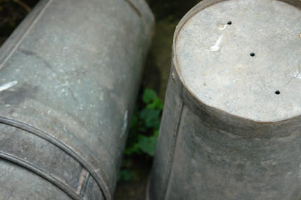 vintage galvanised zinc florist's pot with drainage holes drilled