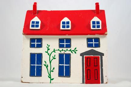 vintage handmade hand painted wooden house with red roof and door