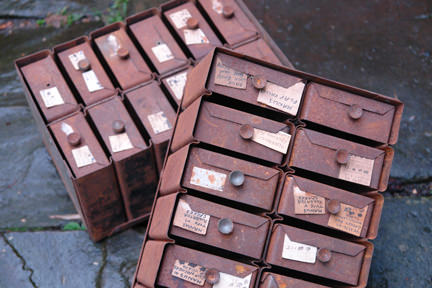 two sets of small rusty industrial vintage drawers