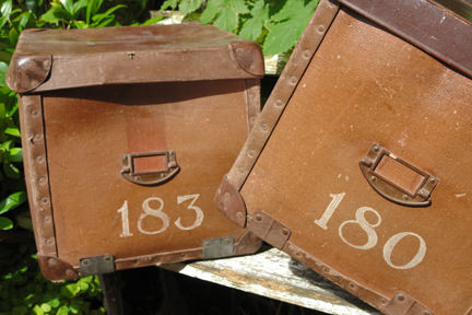 pair of vintage fibreboard leather & metal lost property boxes