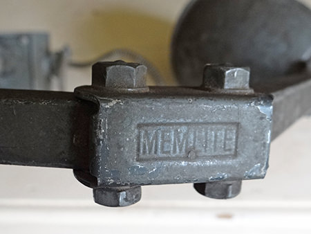 detail of vintage industrial Memlite lamp showing makers mark