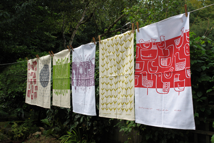 washing line display of 100% cotton hopsack tea towels designed and hand screen printed by Skinny laMinx in Cape Town, South Africa