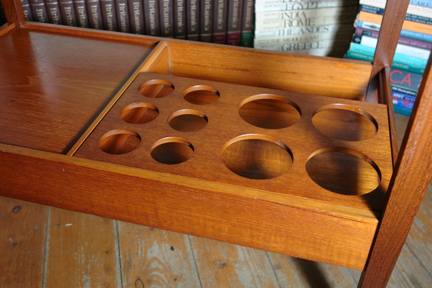 detail of the bottom of a vintage 1950s teak drinks trolley