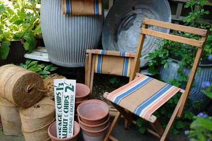 selection of vintage garden items including canvas seated chair, terracotta pots, 3 large reels of jute twine, hand painted fish & chip shop signs and tin dolly tub and bath