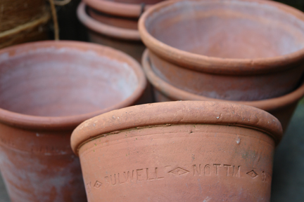 stack of terracotta pots from a selection of vintage garden items