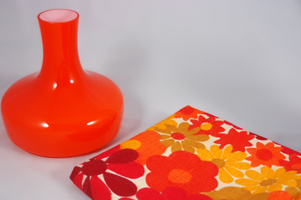 orange cased glass light shade produced by Holmgaard and a quantity of floral fabric in shades of orange