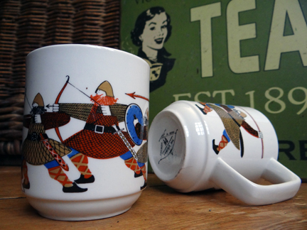 selection of recently acquired vintage homewares including a pair of Figgjo Flint mugs with Viking illustration