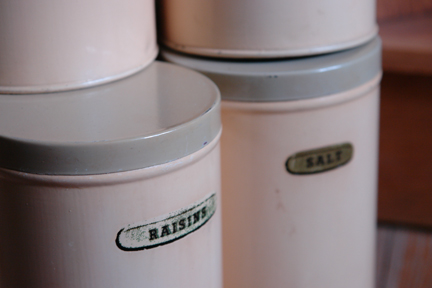 detail from a set of 1950s cream coloured kitchen storage tins