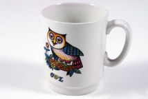 vintage white pottery mug with transfer printed owl figure
