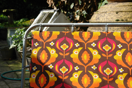 Detail of vintage sun lounger with floral fabric