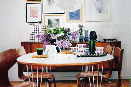 page from Swedish interiors magazine featuring vintage wooden table and chairs