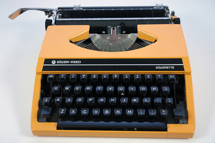 vintage 1970s orange Silver Reed 'Silverette' typewriter