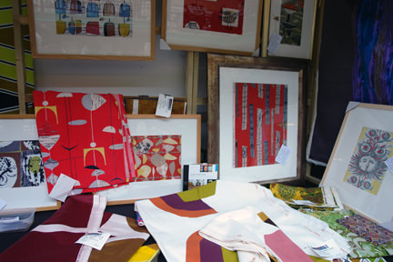 collection of framed vintage fabric swatches