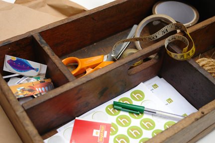 vintage wooden work box being used to store the H is for Home packaging materials & tools