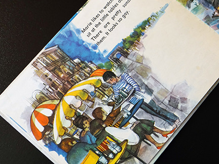 illustration of a pavement café from the France edition in the World Dolls Series of children's books