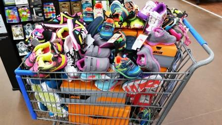 A shopping cart full of shoes for little feet