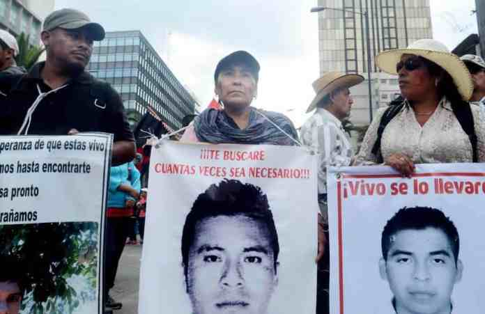 Family members from left , Valentine De La Cruz, Margarita Zacarias and Cristina Bautista, march with in support of the 43 missing students on Mexico City on May 26, 2015.
