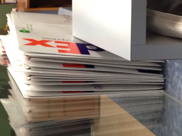 Image result for stack of fedex envelopes