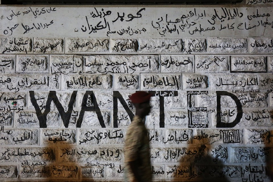 Sudanese protest graffiti WANTED