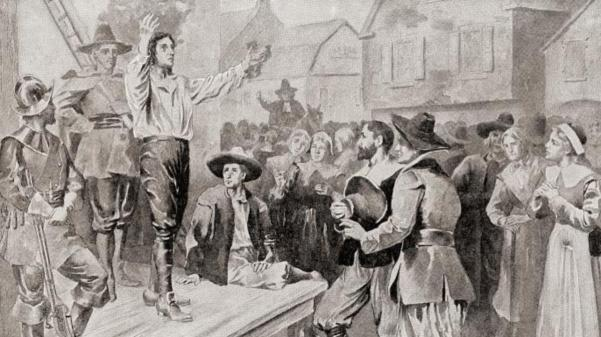 George Burroughs reciting the Lord's Prayer before his execution at Witches Hill in Salem, Massachusetts. (Credit: Classic Image/Alamy Stock Photo)