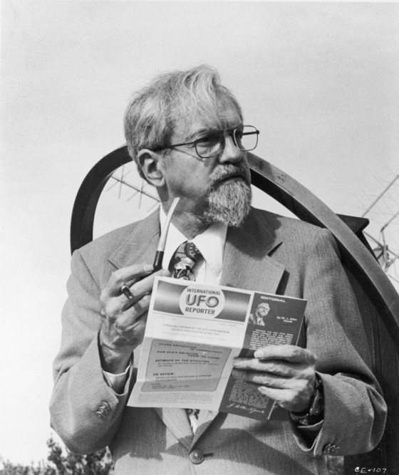 UFO expert Dr. J. Allen Hynek holds a pipe and one of his magazine editorials while serving as technical advisor for the film, 'Close Encounters of The Third Kind.'