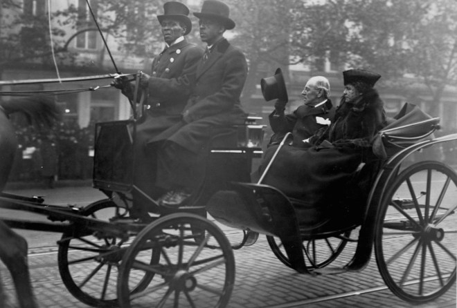 Woodrow Wilson riding in a carriage with First Lady Edith Bolling Galt Wilson, 1921.