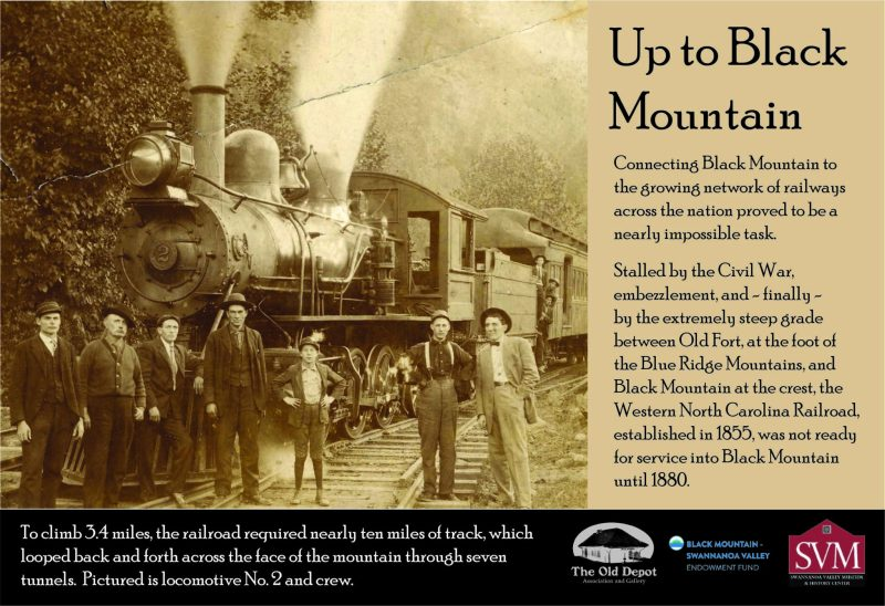 Interpretive Panel with an early 1900s photograph of a train engine and several employee with text describing the process it took to get the railroad up the steep grade between Old Fort and Black Mountain in the late 1800s.