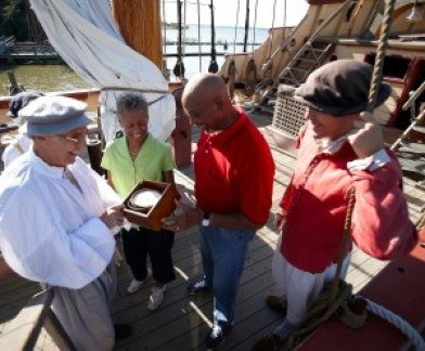 Visitors learn about navigation tools at Jamestown Settlement.