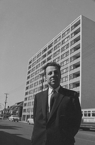 Robert Campeau poses for Ted Grant in front of his still-new Colonel By Towers. Image: Ted Grant / LAC Accession 1981-181 NPC, Series 61-1285, April 17, 1961.