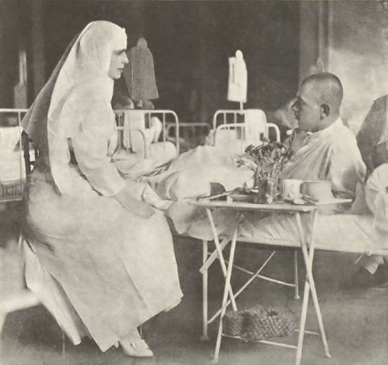 Marie visiting a military hospital, 1917