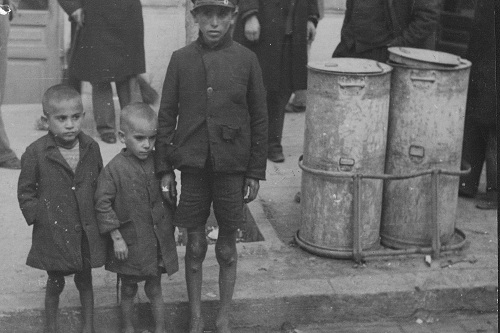 three young children begging for food in panepistemiou road athens, greece in the winter of 1941-1942. reproduced here with kind permission of the international council of the red cross