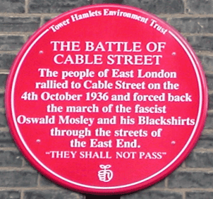 red plaque commemorating the battle of cable street