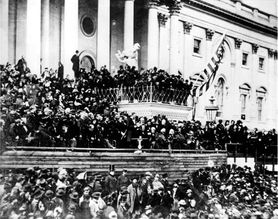 Photo of the second inaugural address of Abraham Lincoln, given on 4 March 1865 on the east portico of the U.S. Capitol, taken in 1865.