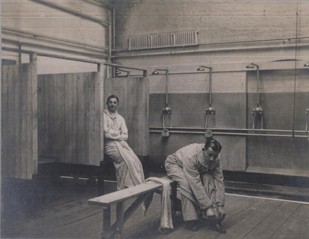 Stratford Camp shower room. Image copright of the Imperial War Museum & Newham Archives.
