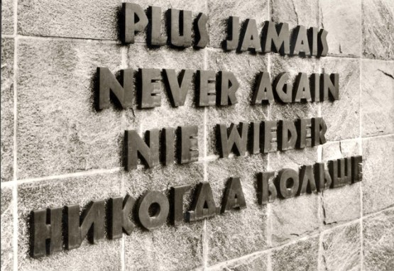Memorial wall with the inscription Never Again - Dachau Germany