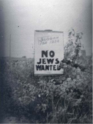 """This sign in Jackson Ontario suggested """"No Jews Wanted"""" as the """"slogan of 1938."""" Image courtesy of the Ontario Jewish Archives."""