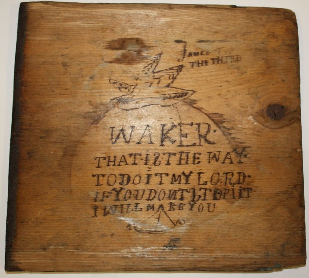 The lid of the box has been inscribed with the words 'James the Third'. A crudely drawn boat is also visible, along with a shell, star, or starfish. Photo: Museum Victoria.