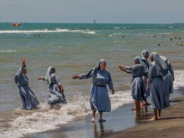 Nuns at the beach