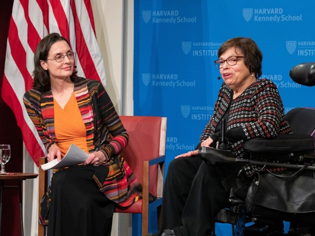 Judith Heumann and Hannah Riley Bowles on stage @ JFK Jr. Forum